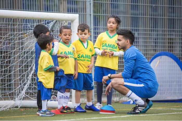 kids with football coach