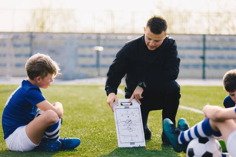 football coach with tactics board
