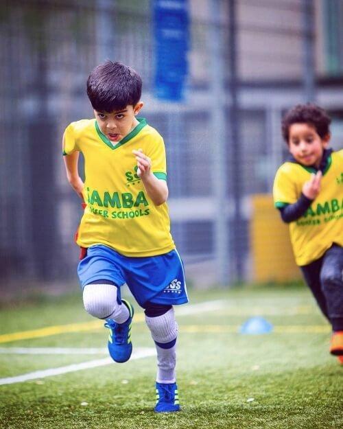 kids running football