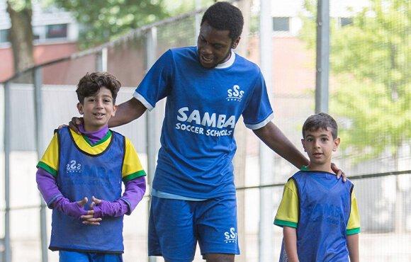 football coach encouraging kids