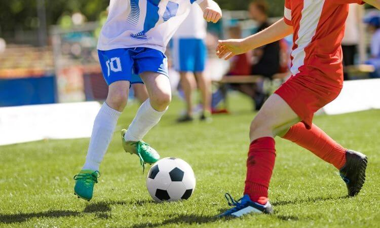 kids football dribbling