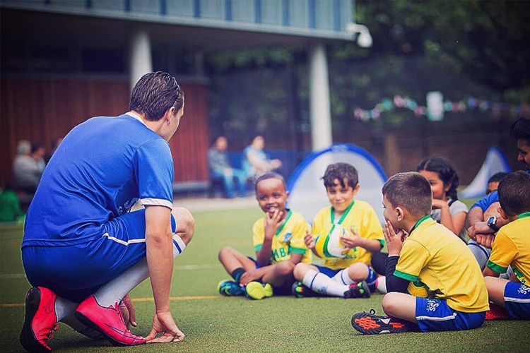 football coach with children
